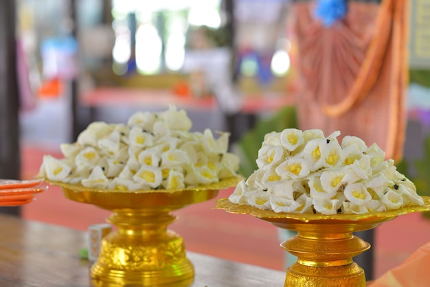 White and yellow sandalwood flowers or artificial flowers for funeral. Premium Photo