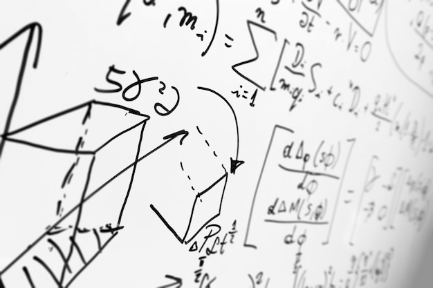 Whiteboard with formulas Free Photo