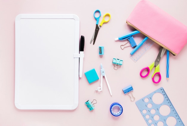 Whiteboard with marker and stationery items Free Photo