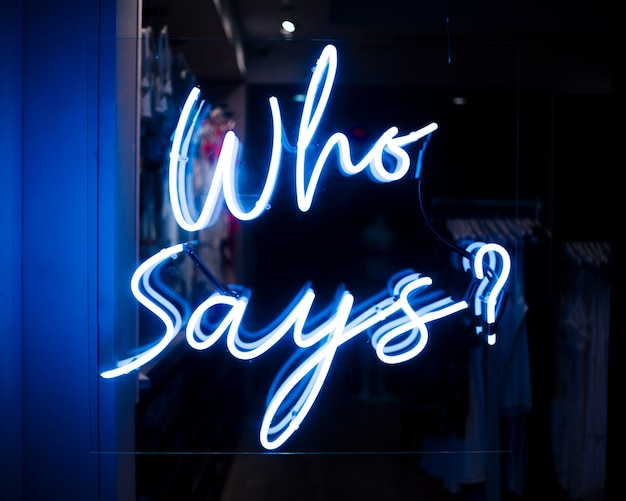 Who says? quote sign in neon lights Free Photo