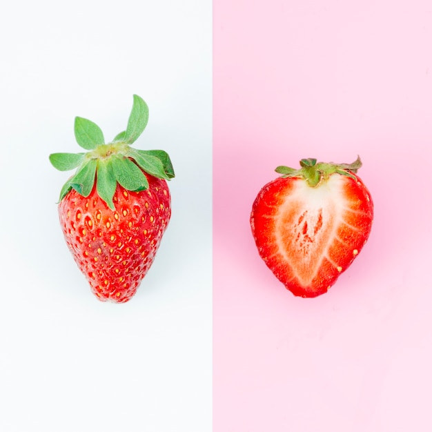 Whole and chopped strawberry on different backgrounds Free Photo