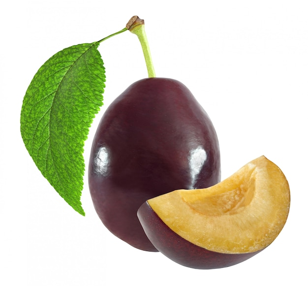 Whole and cut dark plum with leaf isolated on white background with clipping path Premium Photo