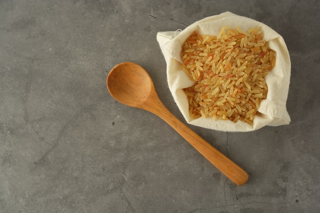 Whole rice heap. wholegrain cereals for healthy food.  copy space. Premium Photo