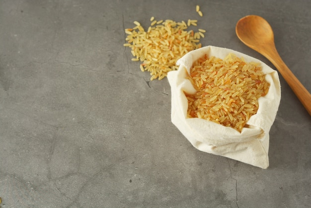 Whole rice heap. wholegrain cereals for healthy food. Premium Photo