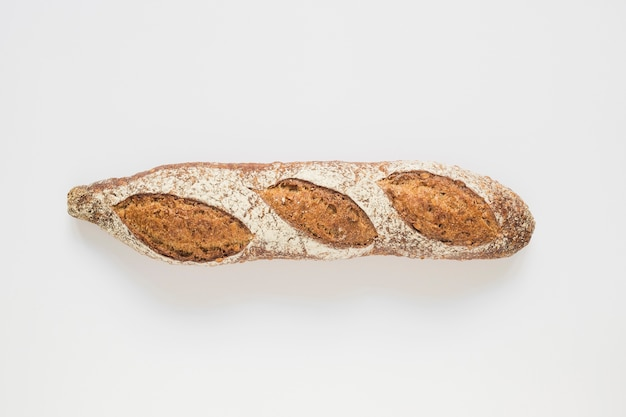 Whole rustic baked baguette on white background Free Photo