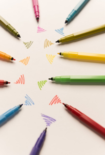 Wi-fi lines drawn with different markers on white paper Free Photo