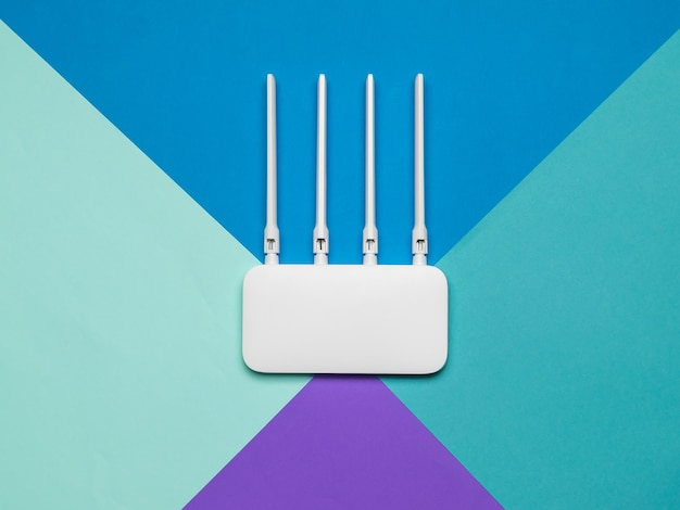 Wi-fi router with four antennas on a four-color background. organization of wireless networks. Premium Photo