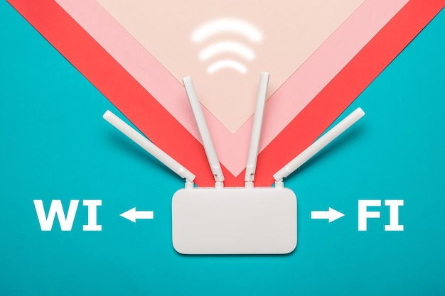 Wi-fi router with a signal icon on a multi-colored background. organization of wireless networks. Premium Photo