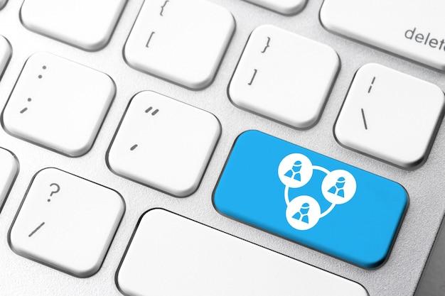 Значок wi-fi и интернет-бизнес на клавиатуре компьютера Premium Фотографии