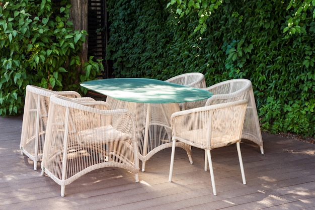 Wicker armchairs and table, modern garden furniture. Premium Photo