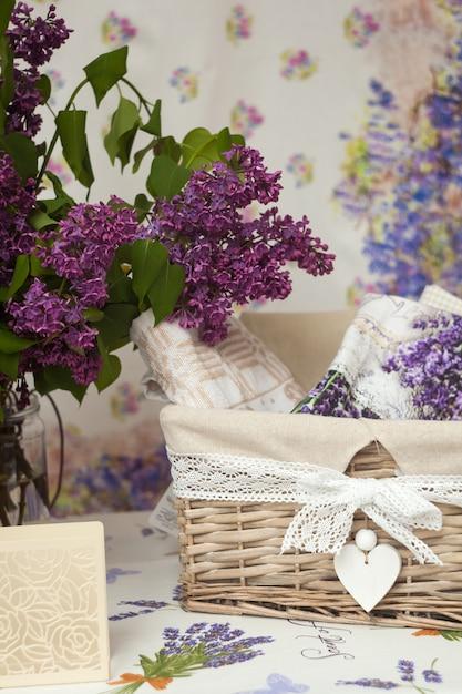 Wicker basket and flowers Premium Photo
