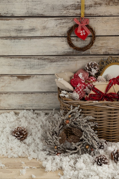 Wicker basket with christmas decoration and fake snow Free Photo