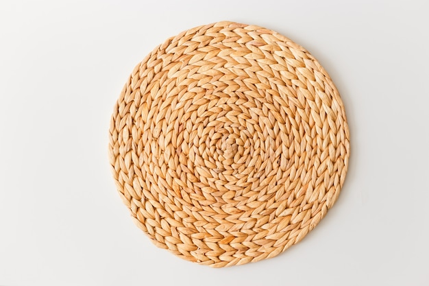 Wicker straw stand isolated on white background. flat lay, top view minimal social media template Premium Photo