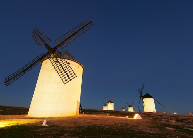 Wide angle shot of group of windmills in night Premium Photo