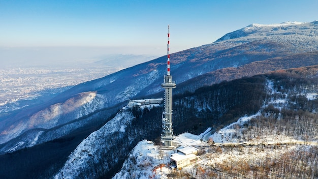 Wide angle shot of a satellite tower on the mountain Free Photo