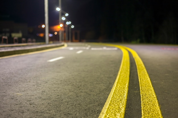 Wide modern smooth empty asphalt highway sharp turn sharp with bright white and double yellow marking sign line. speed, safety, comfortable journey and professional road building concept. Premium Photo