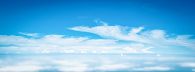 Wide panorama sky clouds above the clouds from airplane window Premium Photo
