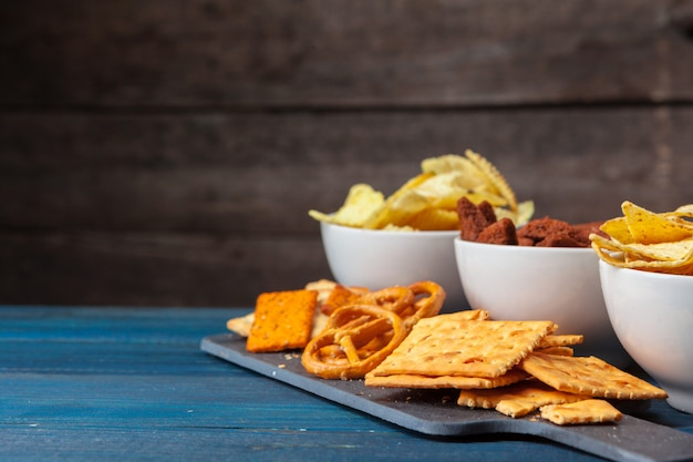 Wide selection of snacks for beer Premium Photo