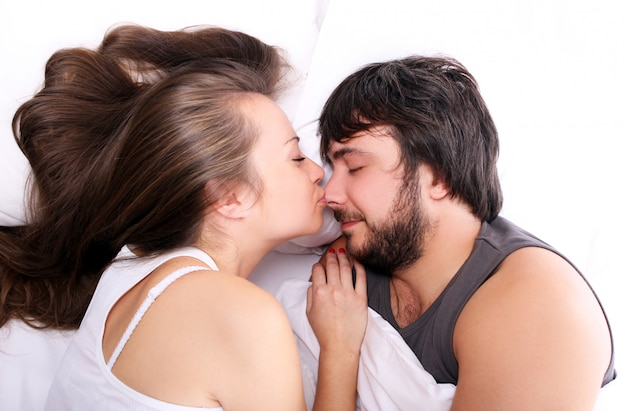 Wife is kissing her husband at nose Free Photo