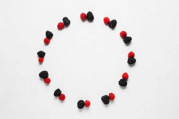 Wild berries and strawberries in a tasty circle Free Photo