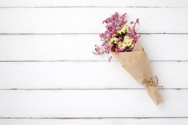 Wild Flower Bouquet On Vintage White Wood Background Photo
