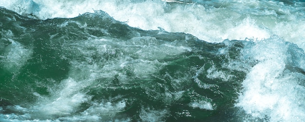 Wild waves at a fast rapids. cold icy eisbach in munich closeup. Free Photo