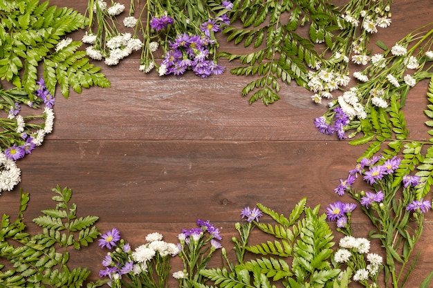 Wildflowers on wooden table Free Photo