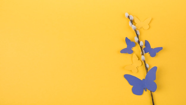 Willow branch with bright paper butterflies Free Photo