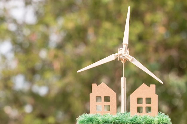 Wind mill with home model Premium Photo