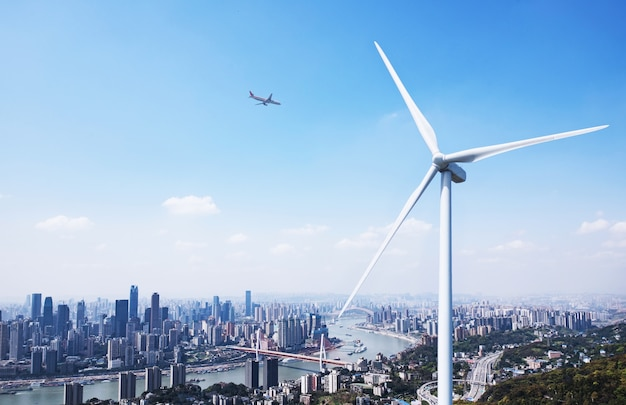 Wind power and urban landscape Free Photo