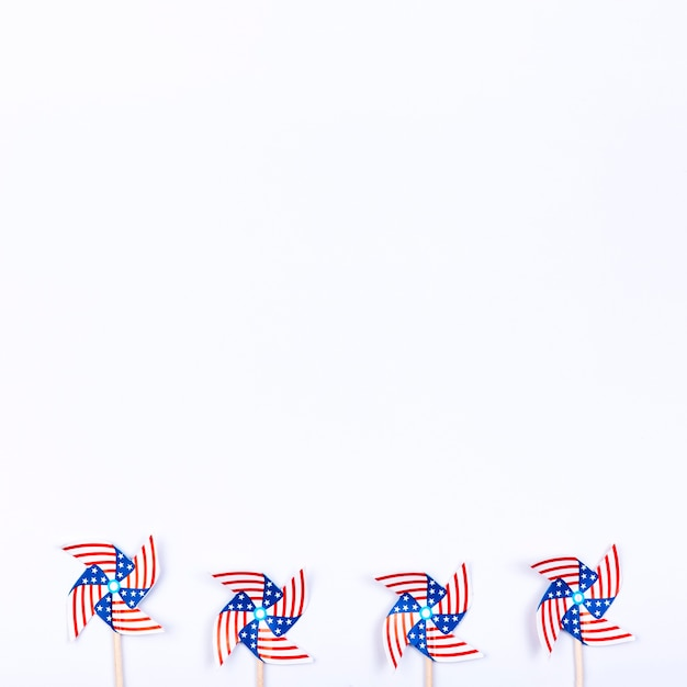 Wind spinners with symbol of american flag placed in row Free Photo