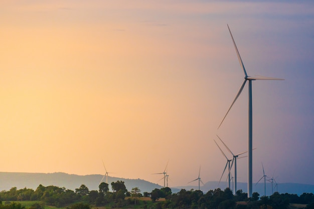 Wind turbine located along the hill with the wind blowing all the time. Premium Photo