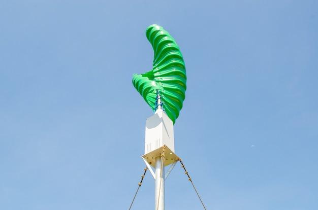 Wind turbine in the vertical spiral shape against blue sky background Premium Photo