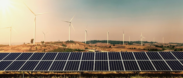 Wind turbine with solar panel on hill and sunshine background. concept clean energy power in nature Premium Photo