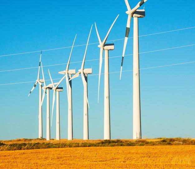 Wind turbines at farmland Free Photo