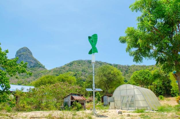 Wind turbines and greenhouse Premium Photo