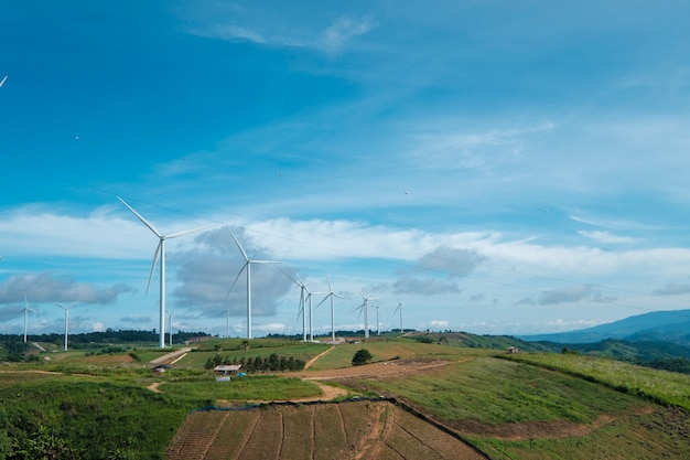 Windmill and blue sky in thailand Free Photo