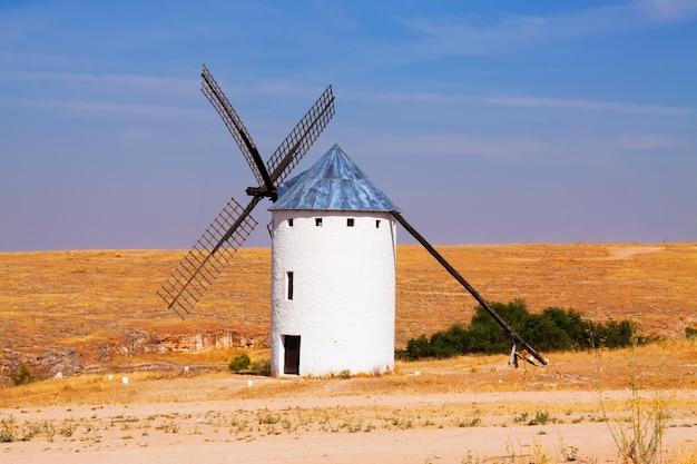 Windmill in field Free Photo