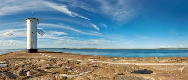 Windmill lighthouse iin swinoujscie, poland, panoramic image Premium Photo
