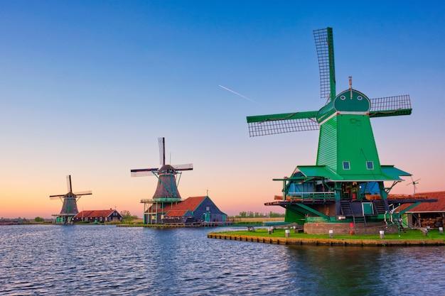 Windmills at zaanse schans in holland on sunset. zaandam, netherlands Premium Photo