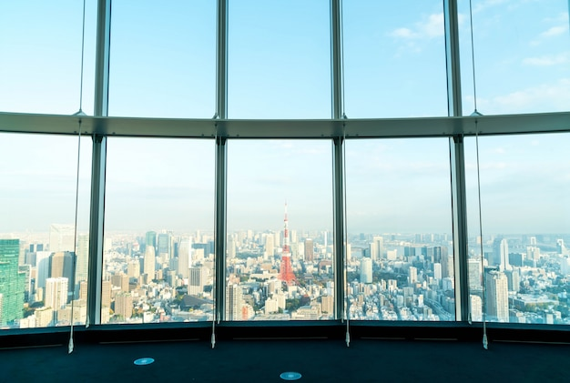 Window of building with tokyo tower background Free Photo