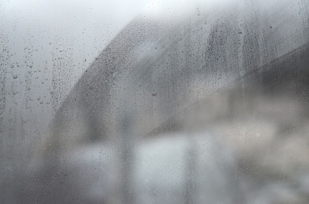 Window glass with condensate or steam after heavy rain, texture or background image Premium Photo