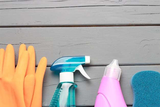Window spray, sponge and gloves on gray Premium Photo