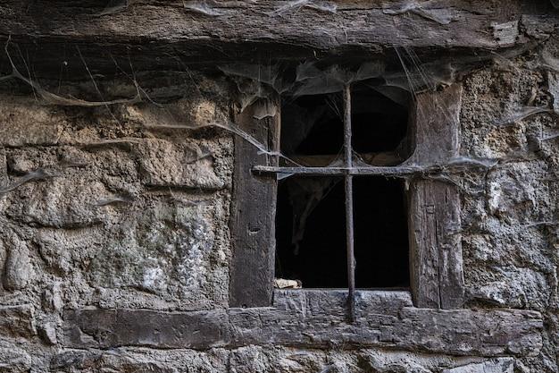 Window with cobwebs Premium Photo