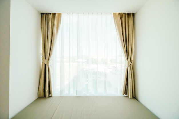 Window with curtain decoration Free Photo