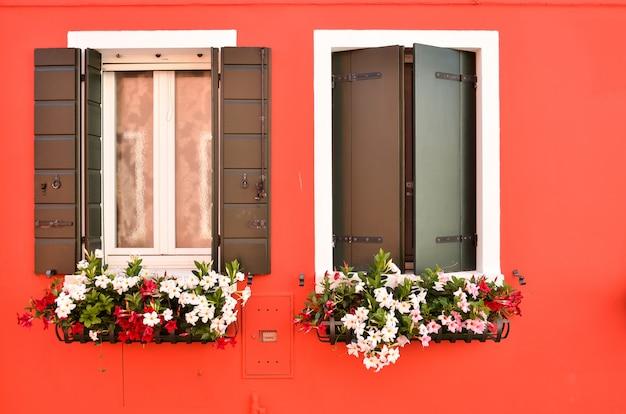Windows with shutters on the island of burano venice italy Premium Photo