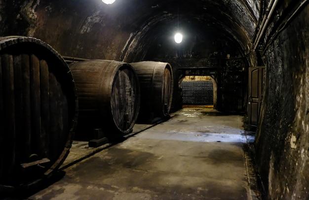 Wine barrels in the cellar. wine cellar at the winery Premium Photo