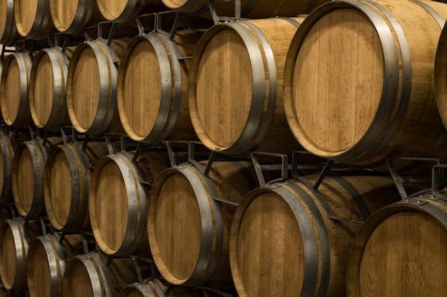 Wine barrels in wine cellar Premium Photo