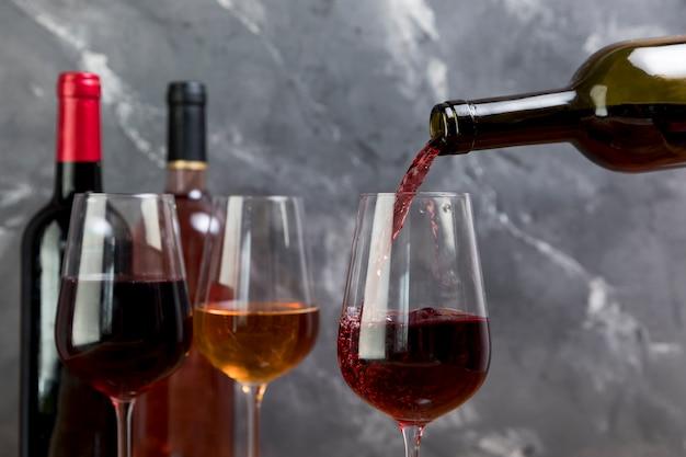A wine bottle filling wineglass Free Photo