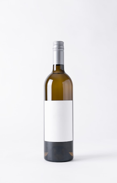 Wine bottle for mock-up. blank label on a gray background. Premium Photo
